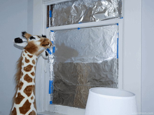 tin foil over windows blackout nursery new mom hack